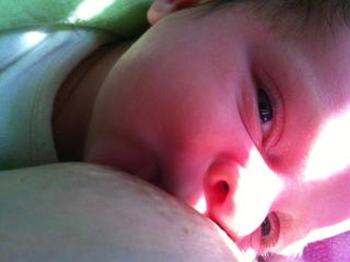 Smiling while breastfeeding