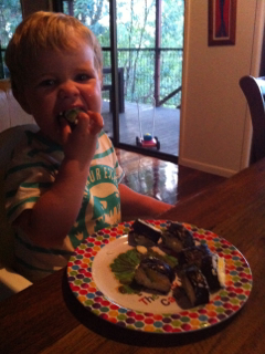 toddler eating sushi