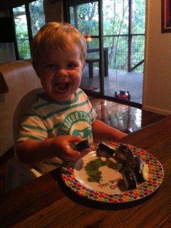 toddler smiling about sushi