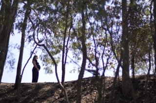 pregnant on a hill